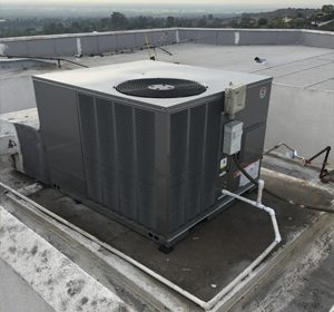 AC installed on business rooftop